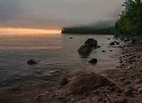 Fog rolls in off of Lake Superior at sunrise at Big Bay Point, Big Bay State Park, Madeline Island, Ashland County, Wisconsin