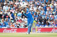 Hardik Pandya (India) lofts Pat Cummins (Australia) straight for six during India vs Australia, ICC World Cup Cricket at The Oval on 9th June 2019