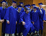 Jake Beaulieu of South Windsor, center, can't resist hamming it up while lining up with classmates for what was suppose to be a formal photo by the East Catholic  photographer prior to the start of the 54th commencement ceremony at the Cathedral of St Joseph, Thursday, June 7, 2018, in Hartford. (Jim Michaud / Journal Inquirer)