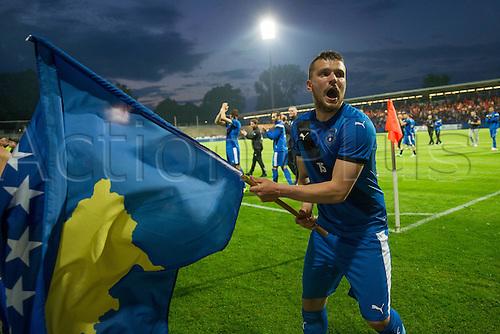 03.06.2016. Volksbank-Stadion, Frankfurt, Germany. International football friendly, Kosovo versus Faroe Islands.  Flamur Kastrati (Kosovo) celebrates their win with the national flag