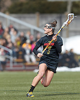 University of Maryland midfielder Katie Schwarzmann (7) brings the ball forward. .University of Maryland (black) defeated Boston College (white), 13-5, on the Newton Campus Lacrosse Field at Boston College, on March 16, 2013.