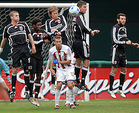 2006 MLS Regular Season Match at RFK Stadium,DC United team Player from right to left Ben Olsen,Bobby Boswell, Brian Carroll, Clyde Simms and Joshua Gros jumping to stop a free kick, and Chivas USA midfielder Jesse Marsch looking at the ball,   final score DC United 2  , Chivas USA  0 , Saturday, April 8.