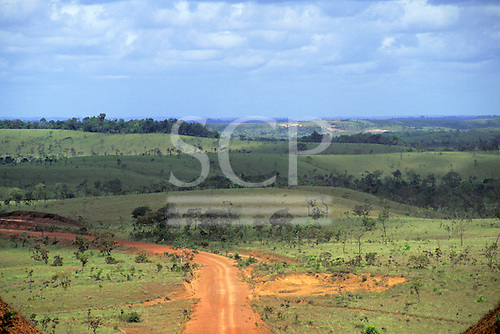 Border between Suriname and Amapa, Brazil. Open countryside with sparse tree cover and dirt roads.