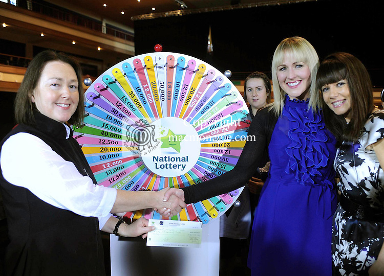Jennifer McCabe from Virginia, County Cavan playing for her brother Kenneth, wins 30,000 euro in the National Lottery's 'Dream Maker Wheel' which she spun at the Munster Table Tennis Championships on Saturday in the INEC, Killarney pictured receiving her cheque from Paula McEvoy of The National Lottery, left and RTE's Geri Maye.<br /> Picture by Don MacMonagle<br /> <br /> <br /> further info from Amy OCallaghan amy.ocallaghan@lottery.ie