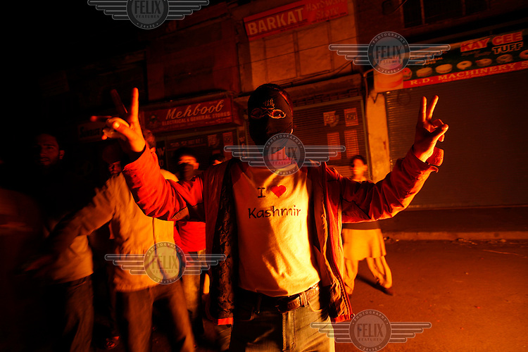 "A youth shows of his  ""I love Kashmir"" t-shirt during protests over the arrest of  separatist leader Yasin Malik.  Srinagar, Kashmir, India. © Fredrik Naumann/Felix Features"