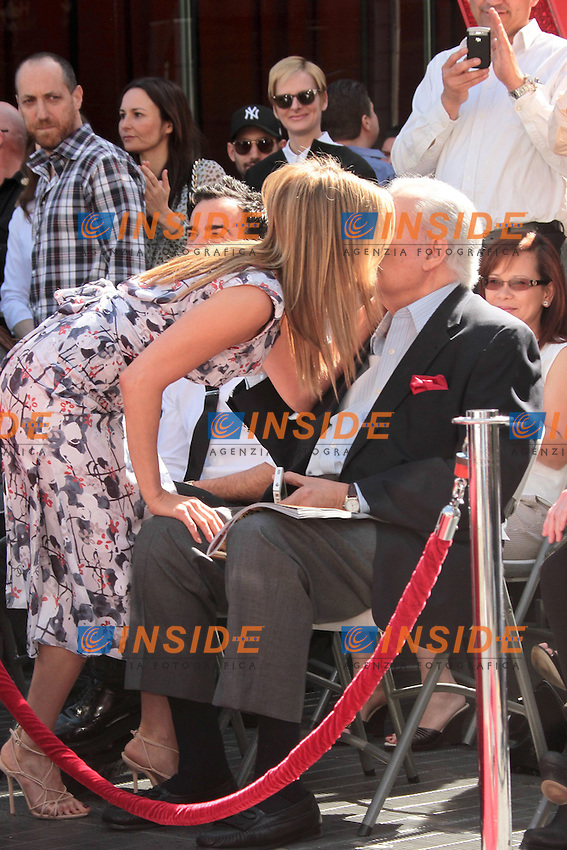 Jennifer Aniston and John Aniston..22/02/2012 Hollywood..Jennifer Aniston Honored with a Star on the Hollywood Walk of Fame on February 22, 2012 ..Stella sulla Hollywood walk of fame per Jennyfer Aniston..Foto Insidefoto / Andrew Evans / PrPrhotos