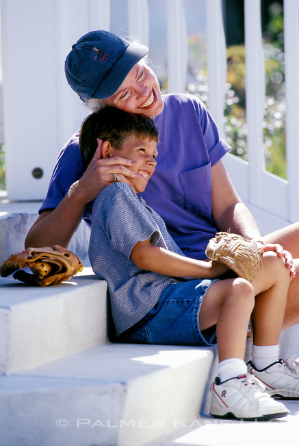 Grandmother and Grandson share a happy moment sitting on porch steps