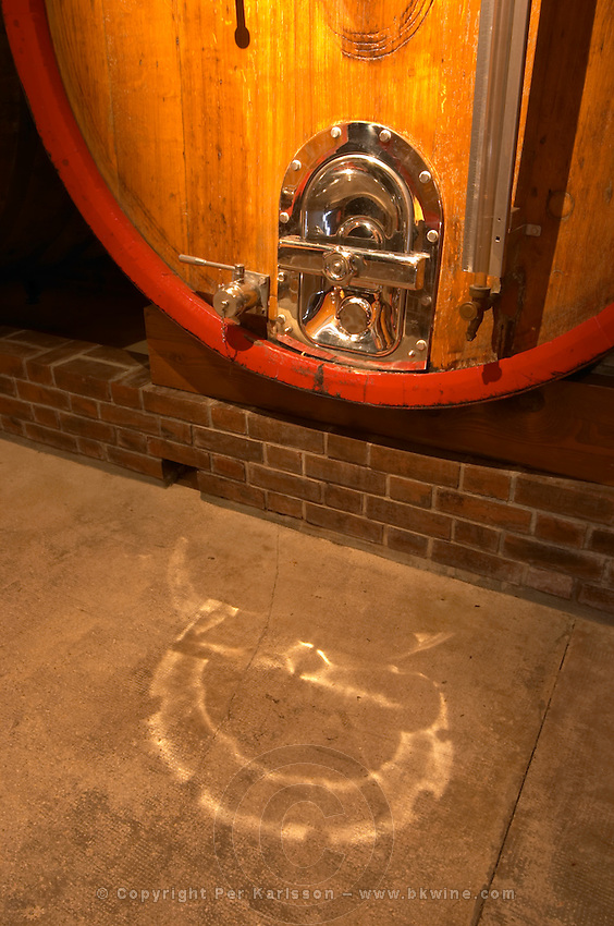 In the wine cellar: la detail of a large oak storage casks with a polished hatch, Champagne Jacquesson in Dizy, Vallee de la Marne, Champagne, Marne, Ardennes, France