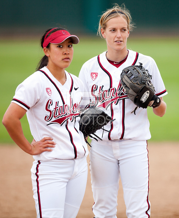 STANFORD, CA - April 2, 2011: Ashley Chinn and Jenna Rich of Stanford softball talk at the mound during Stanford's game against Arizona at Smith Family Stadium. Stanford lost 6-1.