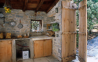 The simple kitchen boasts only the most basic amenities such as a sink, storage and a small stove