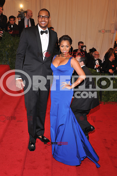 Carmelo Anthony and Lala Anthony at the 'Schiaparelli And Prada: Impossible Conversations' Costume Institute Gala at the Metropolitan Museum of Art on May 7, 2012 in New York City. © mpi03/MediaPunch Inc.