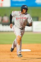 Mario Martinez (10) of the Greenville Drive hustles towards third base against the Kannapolis Intimidators at CMC-Northeast Stadium on June 29, 2013 in Kannapolis, North Carolina.  The Intimidators defeated the Drive 9-3 in the completion of the game that began on June 28, 2013.   (Brian Westerholt/Four Seam Images)