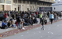Pictured: Hundreds of migrants at the port Friday 26 February 2016<br /> Re: Hundreds of refugees that crossed the border from Turkey to the Greek islands, have arrived at the port of Piraeus near Athens, Greece