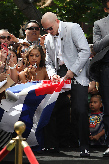 WWW.ACEPIXS.COM . . . . .  ....May 11 2012, LA....Rapper Pitbull at a taping of Extra at The Grove on May 11 2012 in LA....Please byline: Zelig Shaul - ACE PICTURES.... *** ***..Ace Pictures, Inc:  ..Philip Vaughan (212) 243-8787 or (646) 769 0430..e-mail: info@acepixs.com..web: http://www.acepixs.com