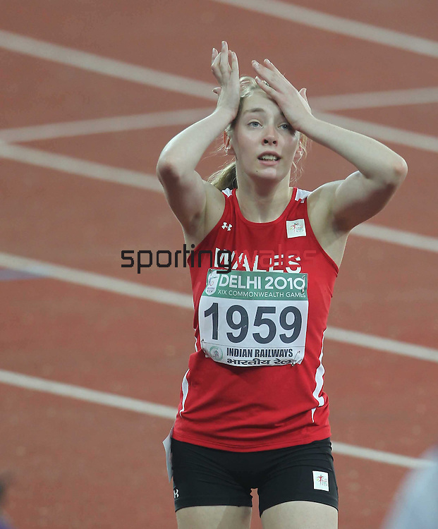 Delhi 2010 Commonwealth Games.Jenny McLoughlin (Wales) waits anxiously at the end of the race for confirmation of her silver medal in the 100m Women T37..07.10.10.Photo Credit-Steve Pope-Sportingwales.