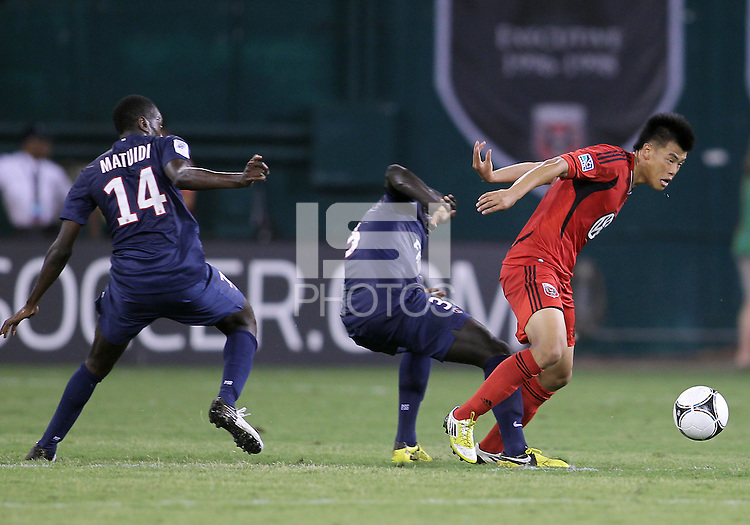WASHINGTON, DC - July 28, 2012:  Long Tan (270 of DC United gets away from Mamadou Sakho (3) and Blaise Matuide (14) of PSG (Paris Saint-Germain) in an international friendly match at RFK Stadium in Washington DC on July 28. The game ended in a 1-1 tie.