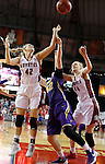 VERMILLION, SD - MARCH 24, 2016 -- Jen Keitel #42 of Northern Iowa battles for a rebound between South Dakota defenders Heidi Hoff #42 and Abigail Fogg #44 during their WNIT game Thursday evening at the Dakotadome in Vermillion, S.D.  (Photo by Dick Carlson/Inertia)