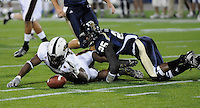 22 November 2008:  FIU defensive back Alonzo Phillips (25) forces Louisiana-Monroe wide receiver Darrell McNeal (3) to fumble a punt return in the ULM 31-27 victory over FIU at FIU Stadium in Miami, Florida.