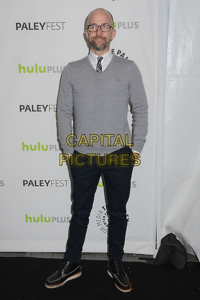 Jim Rash.The Paley Center For Media's PaleyFest 2013 Honoring 'Community' at Saban Theatre, Los Angeles, California, USA.  .March 5th, 2013.full length black jeans denim hands in pockets grey gray sweater jumper top glasses shirt tie check beard facial hair .CAP/ADM/BT.©Birdie Thompson/AdMedia/Capital Pictures.