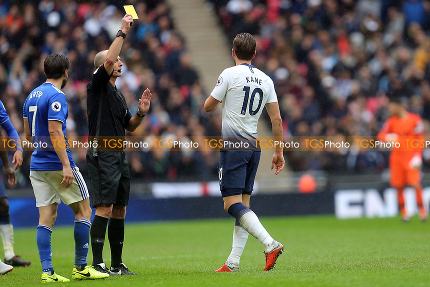 Harry Kane of Tottenham Hotspur is booked by referee Mike Dean during Tottenham Hotspur vs Cardiff City, Premier League Football at Wembley Stadium on 6th October 2018