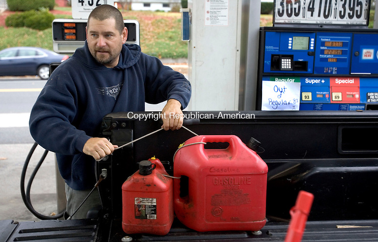 PLYMOUTH, CT. 28 October 2012-102812SV02-Rich Murowsky of Terryville fills gas cans for his generator at the Patco Station on Main Street in Plymouth Sunday. The station was out of regular gas as people prepare for storm Sandy..Steven Valenti Republican-American