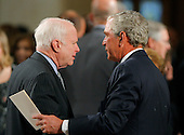 Boston, MA - August 29, 2009 -- United States Senator John McCain (L) talks with former U.S. President George W. Bush (R) as they await the start of. during funeral services for U.S. Senator Edward Kennedy at the Basilica of Our Lady of  Perpetual Help in Boston, Massachusetts August 29, 2009.  Senator Kennedy died late Tuesday after a battle with cancer..Credit: Brian Snyder- Pool via CNP