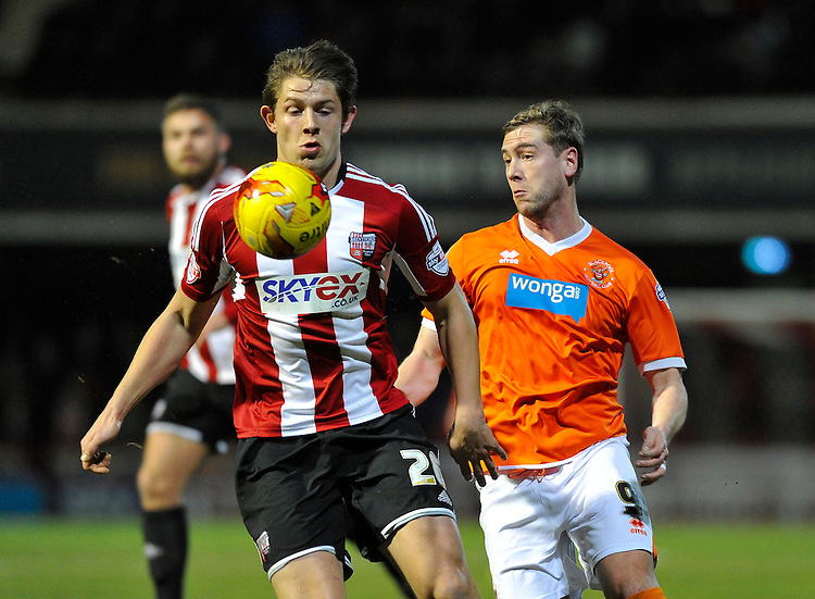 Blackpool's Steven Davies battles with Brentford's James Tarkowski<br /> <br /> Photographer Ashley Western/CameraSport<br /> <br /> Football - The Football League Sky Bet League One - Brentford v Blackpool - Tuesday 24th February 2015 - Griffin Park - London<br /> <br /> &copy; CameraSport - 43 Linden Ave. Countesthorpe. Leicester. England. LE8 5PG - Tel: +44 (0) 116 277 4147 - admin@camerasport.com - www.camerasport.com