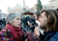 Una donna soccorre un manifestante del movimento degli indignados rimasto ferito dopo lo sgombero effettuato dalle forze dell'ordine in Piazza San Pietro, Citta' del Vaticano, 14 gennaio 2012..A demostrator of the International Indignados movement is helped by a woman after being injured as police officers moved them out of St. Peter's square, at the Vatican, 14 january 2012. .UPDATE IMAGES PRESS/Riccardo De Luca