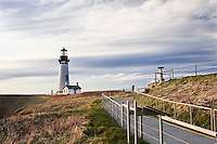 Yaquina Head Lighthouse, Oregon Coast near Newport, Oregon.  Oregon Central Coast, beaches, bays, bars, family fun, winter storms, lighthouses, fishing boats, bluffs, fossils and beach walks.