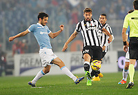 Marco Parolo  and  Ferdinando Llorente    in action during the Italian Serie A soccer match between   SS Lazio and FC Juventus   at Olimpico  stadium in Rome , November 22, 2014