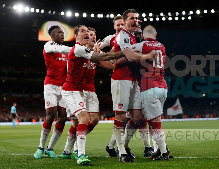 Alexandre Lacazette of Arsenal is mobbed at the players celebrate the first goal during the Europa League Semi Final 1st Leg, match at the Emirates Stadium, London. Picture date: 26th April 2018. Picture credit should read: David Klein/Sportimage