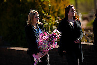 Tuesday 11 March 2014<br /> Pictured:Mourners carry flowers<br /> Re: Funeral of Baby Eliza Mae takes place in Pontyberem, Wales UK