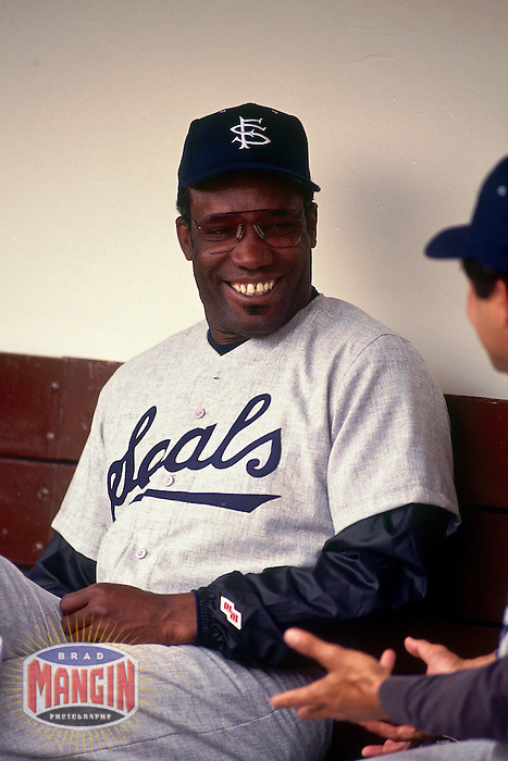 OAKLAND, CA - Hitting coach Bobby Bonds of the San Francisco Giants sits in the dugout on Turn Back the Clock Day wearing a San Francisco Seals uniform during an exhibition game against the Oakland Athletics at the Oakland Coliseum in Oakland, California on April 5, 1994. Photo by Brad Mangin