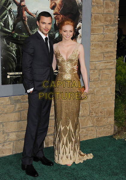 "Nicholas Hoult & Eleanor Tomlinson.""Jack The Giant Slayer"" Los Angeles Premiere held at Grauman's Chinese Theatre, Hollywood, California, USA..February 26th, 2013.full length dress cleavage clutch bag hand in pocket gold metallic beads beaded black tie white shirt blue suit jacket stubble facial hair .CAP/ROT/TM.©Tony Michaels/Roth Stock/Capital Pictures"