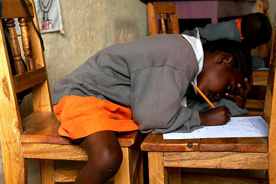 Ashu Abubakar works on her final at the Early Childhood Development school at Pepo La Tumaini Jangwani, a community based HIV/AIDS program in Isiolo, Kenya., on Tuesday, July  29, 2008.  (Photo by Bryce Yukio Adolphson, © 2008)