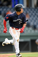 Third baseman Tanner Nishioka (30) of the Greenville Drive runs out a batted ball in Game 1 of a doubleheader against the Hickory Crawdads on Wednesday, July 25, 2018, at Fluor Field at the West End in Greenville, South Carolina. Greenville won, 4-1. (Tom Priddy/Four Seam Images)