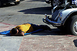 MAN SLEEPING ON MAT ON MALECON