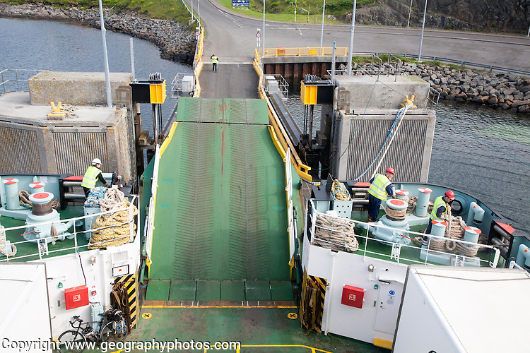 Ship workers on Caledonian MacBrayne ferry leaving Castlebay, Barra, Outer Hebrides, Scotland, UK