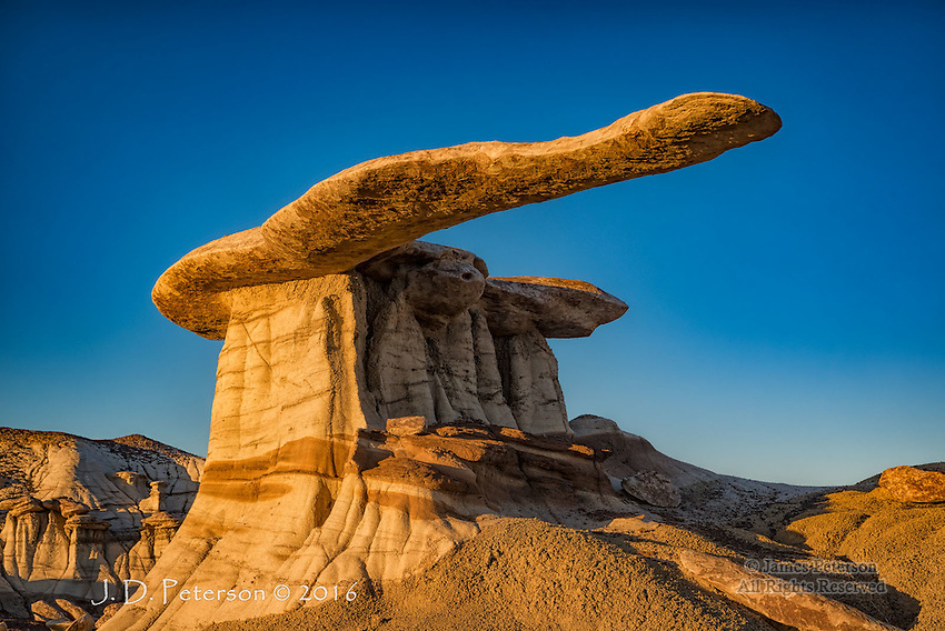 King of Wings at Sunset, New Mexico ©2016 James D Peterson.  This is one of the more amazing, and precarious, rock formations anywhere.  It is in a badlands area of  the Ah-shi-sle-pah wash, a very remote part of San Juan County, New Mexico.