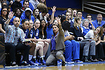 20 March 2015: Duke head coach Joanne P. McCallie kneels in front of her bench and calls a play. The Duke University Blue Devils hosted the University at Albany Great Danes at Cameron Indoor Stadium in Durham, North Carolina in a 2014-15 NCAA Division I Women's Basketball Tournament first round game.