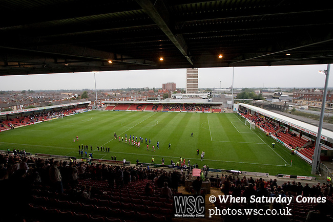 The teams taking the field at the Alexandra Stadium prior to the League 2 fixture between Crewe Alexandra and Aldershot Town, as seen from the back of the main stand. The visitors won by 2 goals to 1.