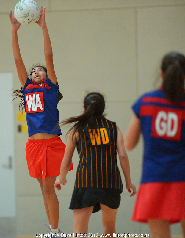 Action from the Chilton (red and blue) v Wellington Girls' College semifinal of the 2012 College Sport Wellington Junior Netball Tournament at ASB Sports Centre, Kilbirnie, Wellington, New Zealand on Thursday, 9 August 2012. Photo: Dave Lintott / lintottphoto.co.nz