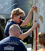 Washington, DC - June 22, 2002 -- White House Counselor Karen Hughes tries her hand at the Climbing Wall as part of the President's Fitness Challenge at Fort McNair in Washington on 22 June, 2002.<br /> Credit: Ron Sachs / Pool via CNP