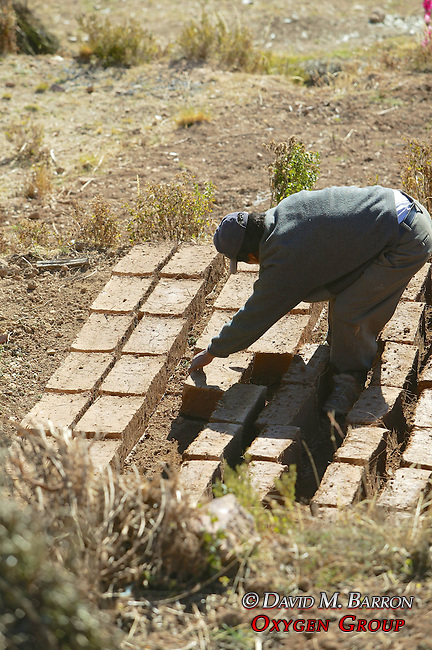 Man And Drying Adobe Bricks