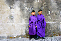 Two young boys in purple robes of Catholic church