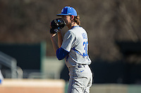 Kentucky Wildcats starting pitcher Sean Hjelle (30) looks to his catcher for the sign against the North Carolina Tar Heels at Boshmer Stadium on February 17, 2017 in Chapel Hill, North Carolina.  The Tar Heels defeated the Wildcats 3-1.  (Brian Westerholt/Four Seam Images)