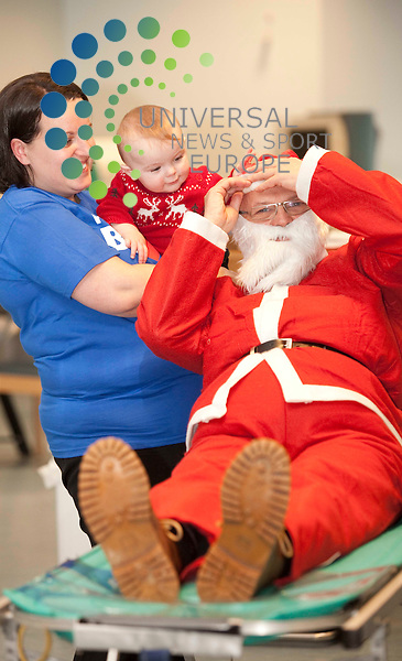 Call for blood donations over the winter and festive season: Miracle mum Fiona Griffin and Ben, eight months, meet Santa at the Blood Donor Centre, Glasgow. Fiona owes her life to blood donors. She lost half of her blood and went into shock after giving birth to Ben. Shee was rushed to theatre and her life was saved by donated blood. Picture Johnny Mclauchlan/Universal News and Sport (Scotland)30/11/2010