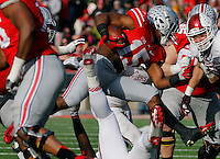 Ohio State Buckeyes running back Ezekiel Elliott (15) tries to break through the Hoosier defense in the fourth quarter of their game at Ohio Stadium in Columbus, Ohio on November 22, 2014. (Columbus Dispatch photo by Brooke LaValley)