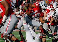 Ohio State Buckeyes running back Ezekiel Elliott (15) tries to break through the Hoosier defense in the fourth quarter of their game at Ohio Stadium in Columbus, Ohio on November 22, 2014. (Columbus Dispatch photo by Brooke LaValley)