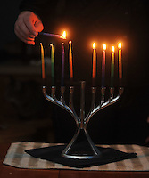 "Photo Illustration  NWA Democrat-Gazette/MICHAEL WOODS • The lighting of the menorah is a big part of Hanukkah, the 8-day Jewish festival of light.  Hanukkah celebrates religious freedom and the triumph of light over darkness. Hanukkah means ""dedication"" and refers to the rededication of the Holy Temple in Jerusalem at the end of the war.  Hanukkah is observed for eight nights and days, starting on the 25th day of Kislev according to the Hebrew calendar."